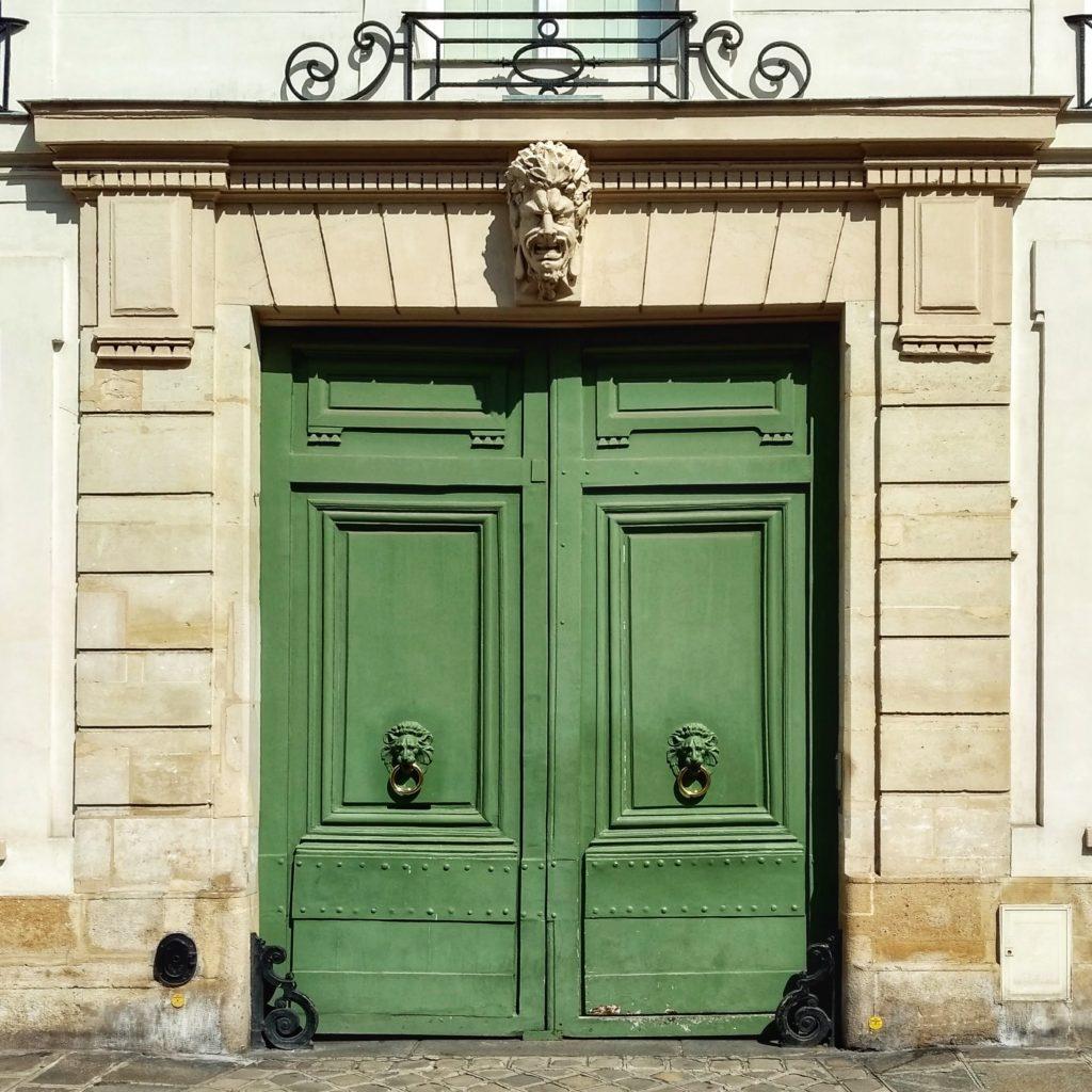 green doors lion head door knockers stone grotesque 46 rue de Varenne