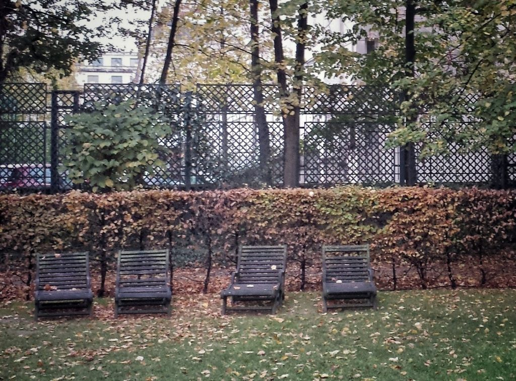 Musée Rodin garden Paris leaves on grass wooden chaise lounges