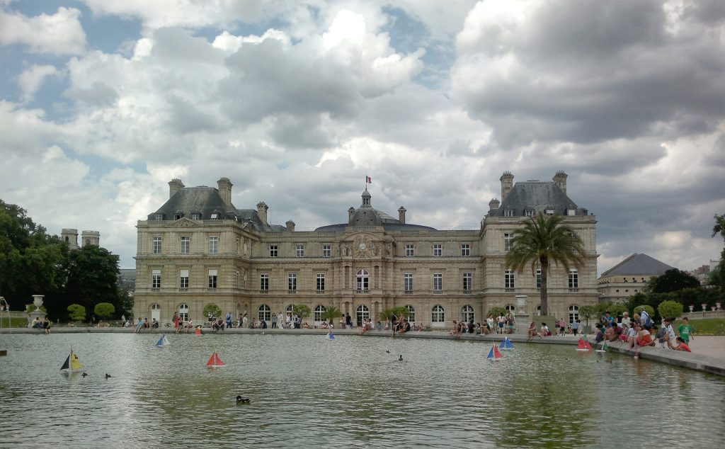 pond with boats Jardin du Luxembourg Paris cloudy sky