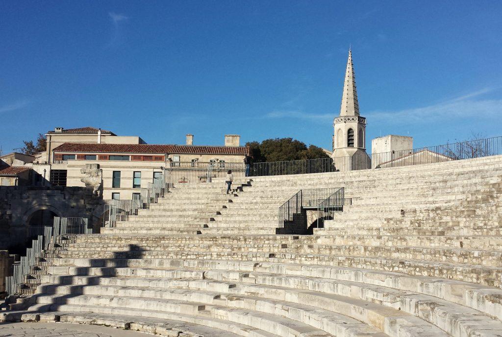 Roman Theatre Arles stone seats blue sky steeple