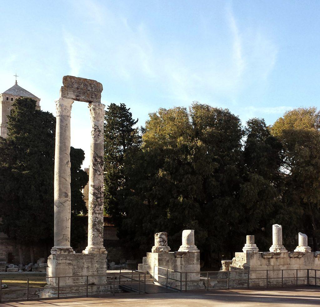 Roman Theatre Arles column fragments blue sky trees