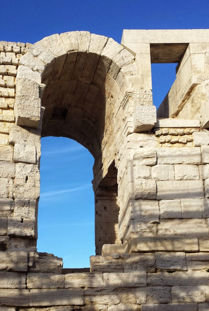 exterior Roman Arles amphitheatre arches blue sky
