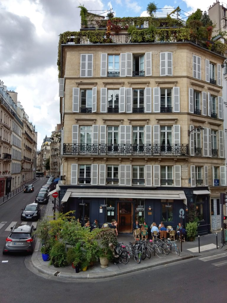 view from second story window building cafe terrace clouds Paris Judy's