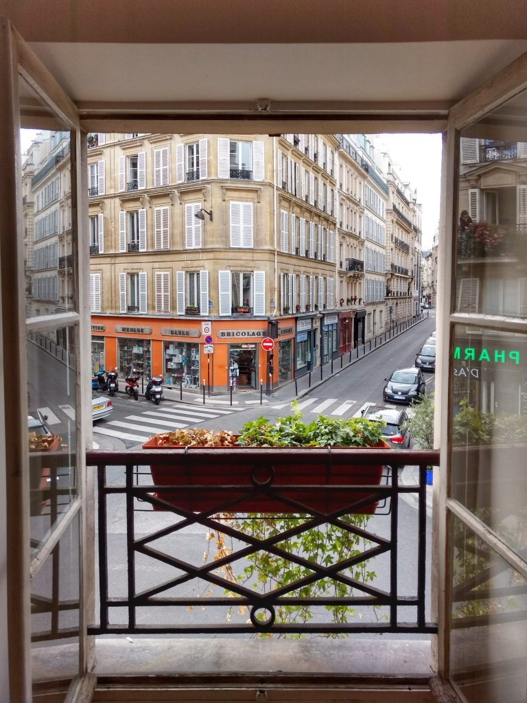 view from second story window Paris street corner Judy's