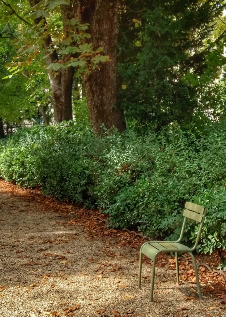 park green chair path bushes trees Jardin du Luxembourg