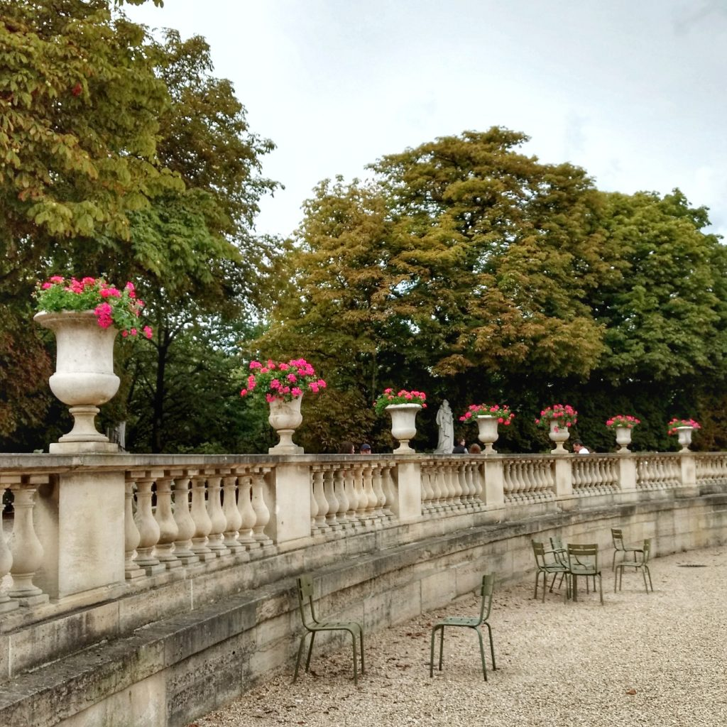 park pink petunias stone urns balustrade chairs trees Jardin du Luxembourg