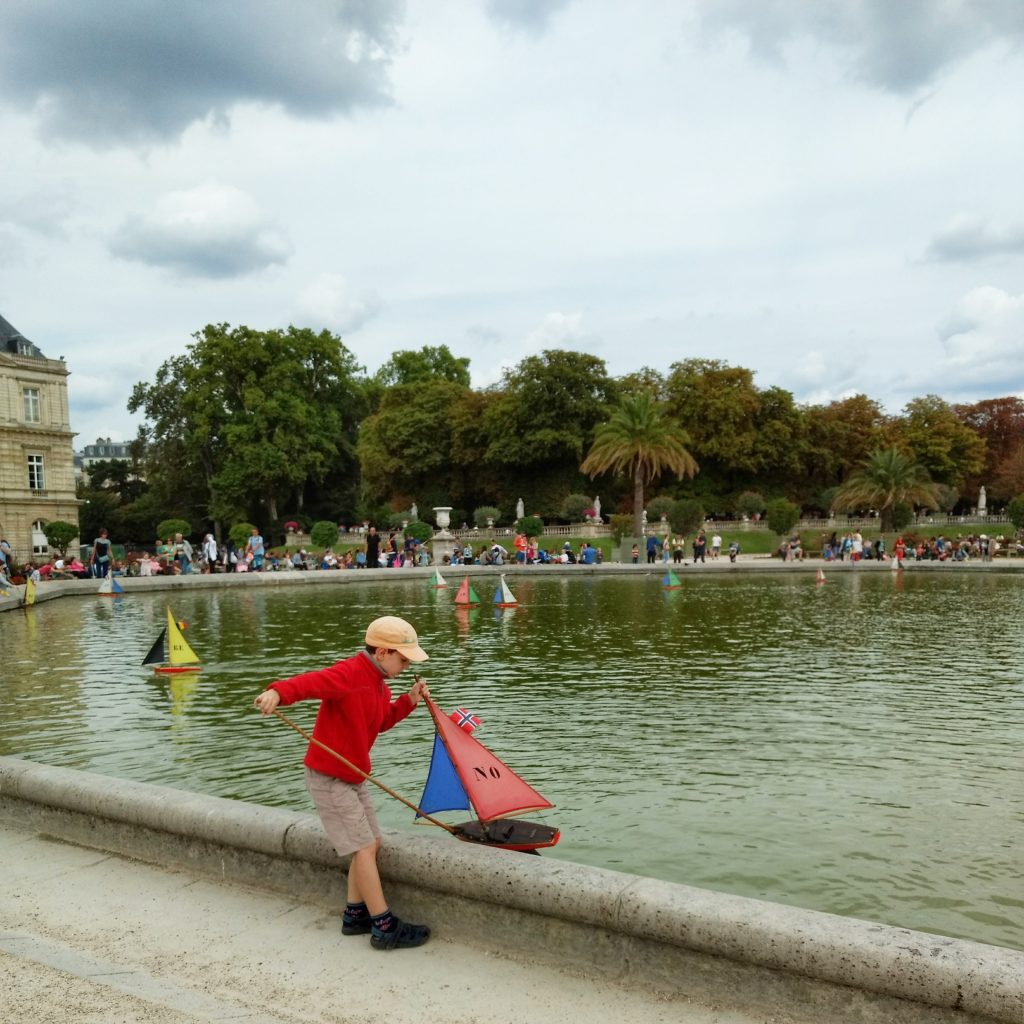 park pond boy with toy boat Jardin du Luxembourg