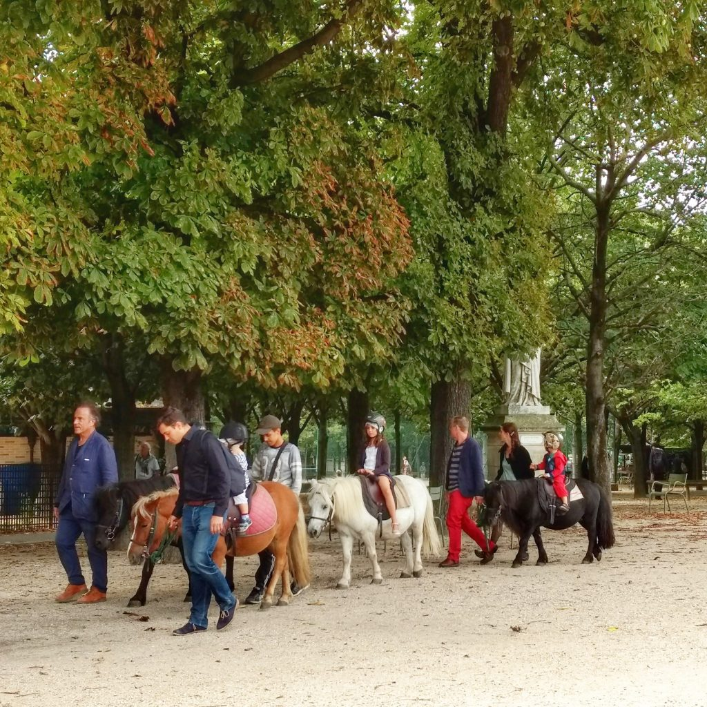 park children pony ride trees Jardin du Luxembourg