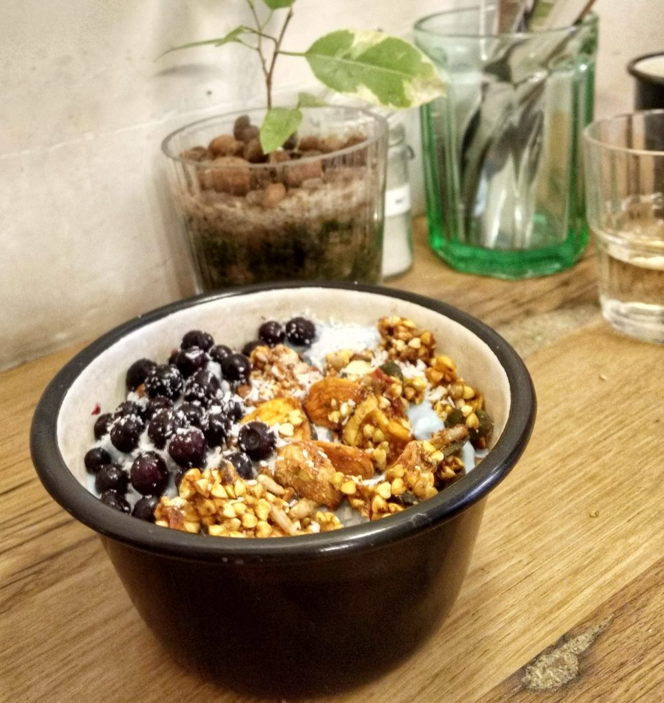 smoothie bowl granola wood table