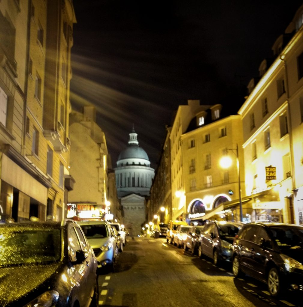 night scene of rue des Carmes Pantheon illuminated at end of street