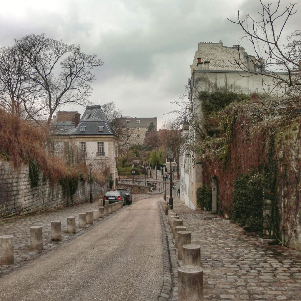Montmartre cloudy day cobblestone street stone wall with vines