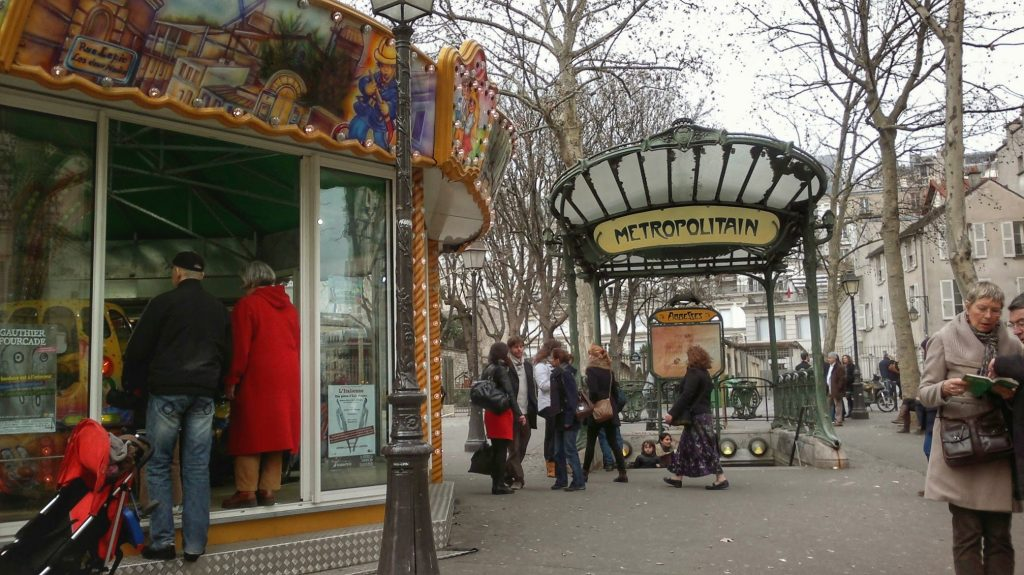Art Nouveau Metropolitain awning in Paris, merry-go-round, cloudy day