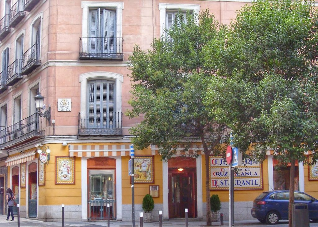 street corner Madrid yellow tiled cerveceria bar