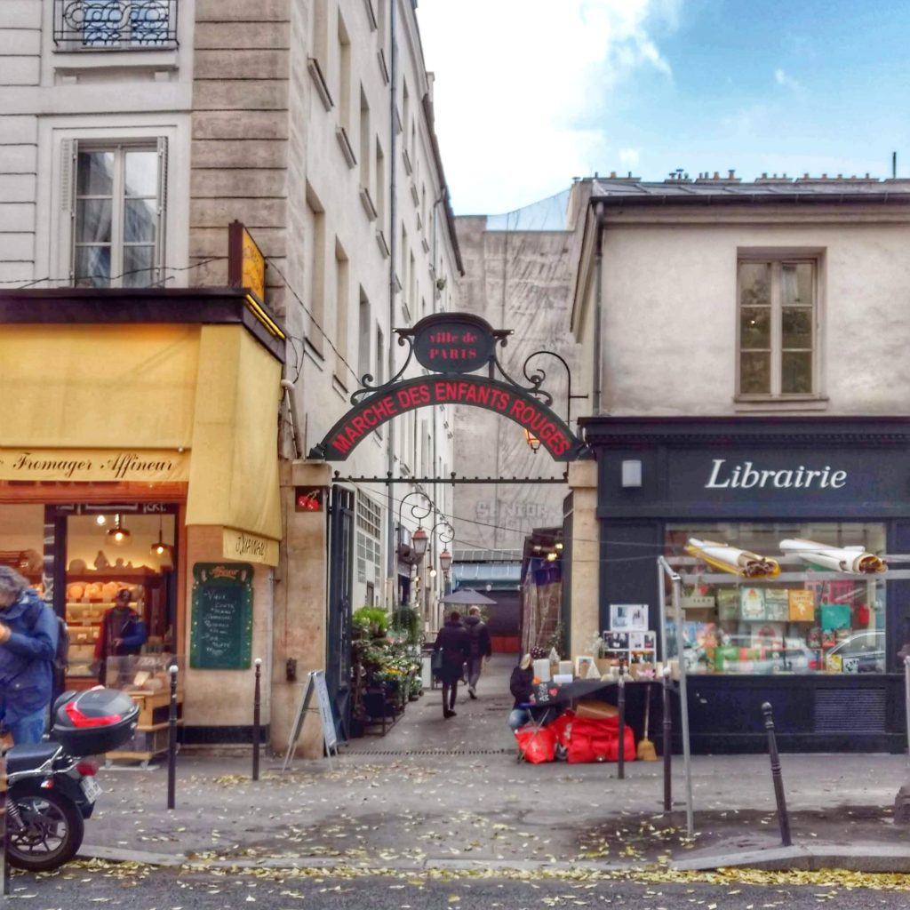 Paris street fall leaves entrance to Marche des Enfants Rouges marktet