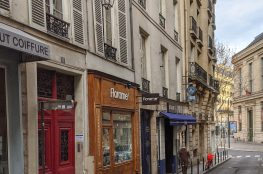Paris street stone buildings store fronts
