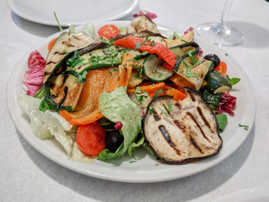 grilled vegetables on a bed of lettuce