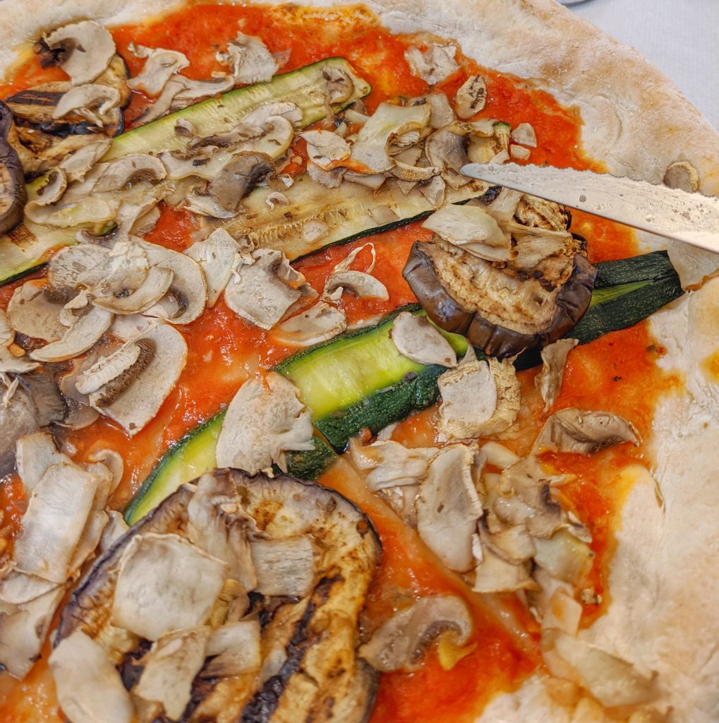 vegan gluten-free pizza with mushrooms zucchini eggplant