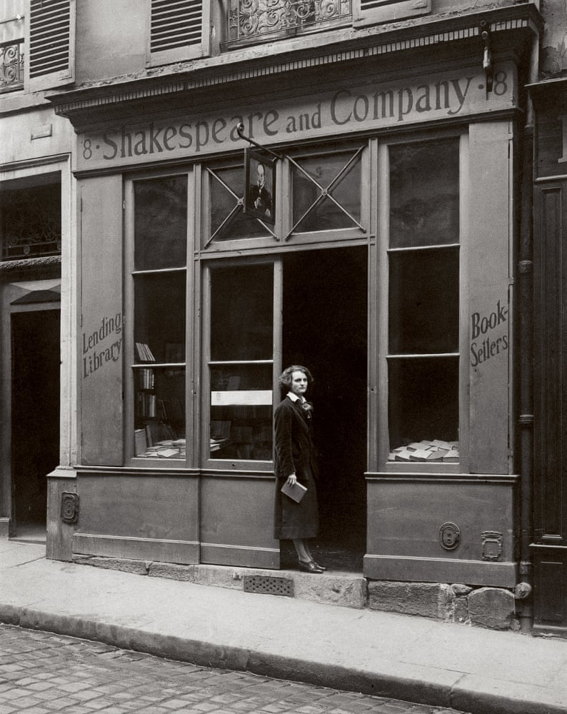early 20th century black and white photograph woman Parisian bookstore storefront